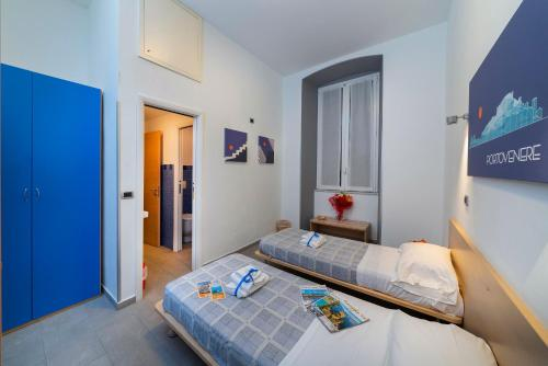 A bed or beds in a room at Affittacamere del Golfo e delle 5 Terre