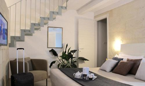 Area soggiorno di UP Room&Suite