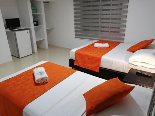 A bed or beds in a room at Posada Santa Catalina