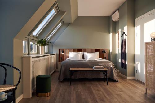 Кровать или кровати в номере Coco Hotel