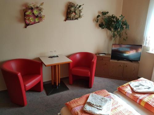 Ein Sitzbereich in der Unterkunft Hotel Arkona