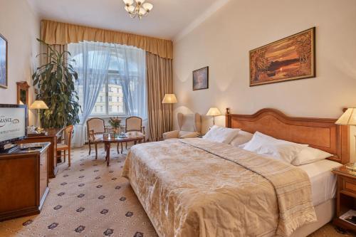 Postel nebo postele na pokoji v ubytování Hotel Romance