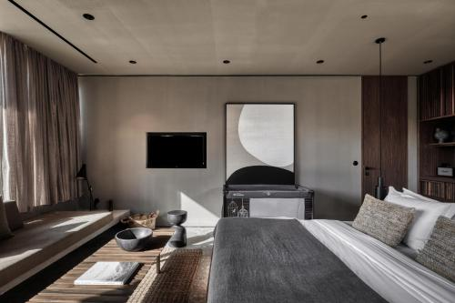 A television and/or entertainment centre at Domes Zeen Chania, a Luxury Collection Resort, Crete