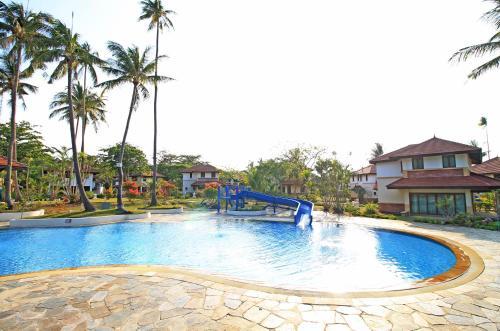 The swimming pool at or near Banyu Biru Villa