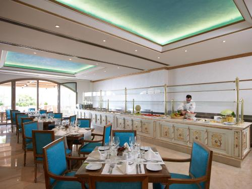 A restaurant or other place to eat at Mitsis Laguna Resort & Spa