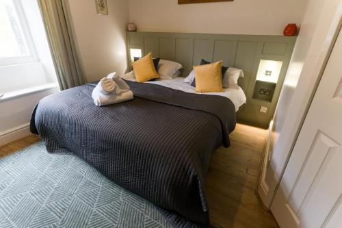A bed or beds in a room at Lancrigg Hotel & Kitchen
