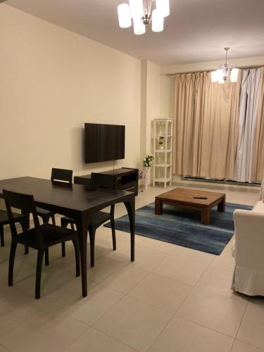 A television and/or entertainment center at Cozy Upgraded 1 bedroom Hall in Dubai Silicon Oasis