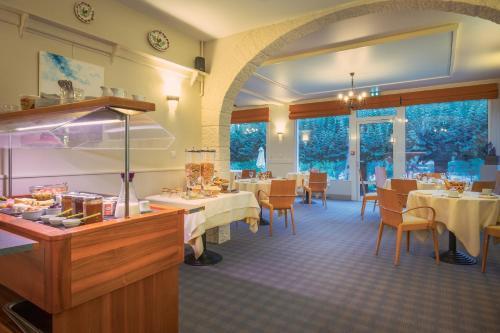 Restaurant ou autre lieu de restauration dans l'établissement Le Coq Hardi