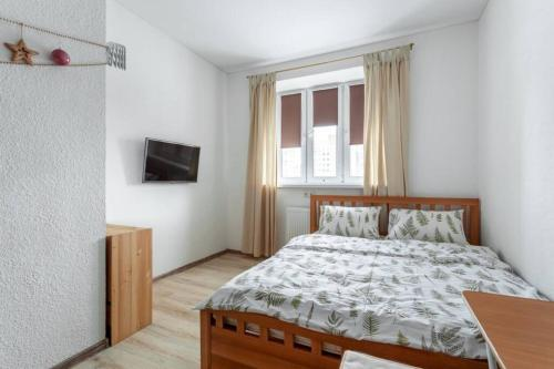 A bed or beds in a room at Katuar Life Apartments