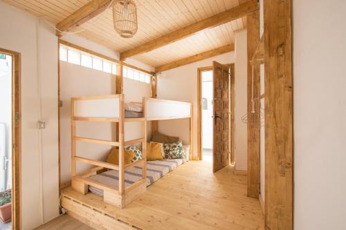 A bunk bed or bunk beds in a room at Casa Calma Yoga Guesthouse
