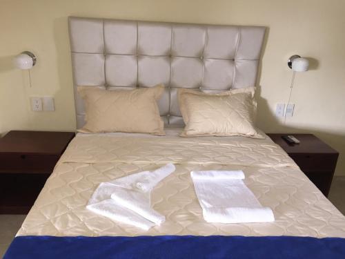 Ein Bett oder Betten in einem Zimmer der Unterkunft Hotel Cotubanama Samaná