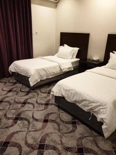 Cama ou camas em um quarto em The New Address Furnished Apartments