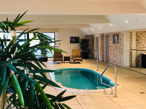 The swimming pool at or near Domaine De Saint Clair Spa & Golf