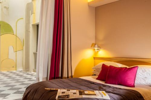 A bed or beds in a room at Herodion Hotel