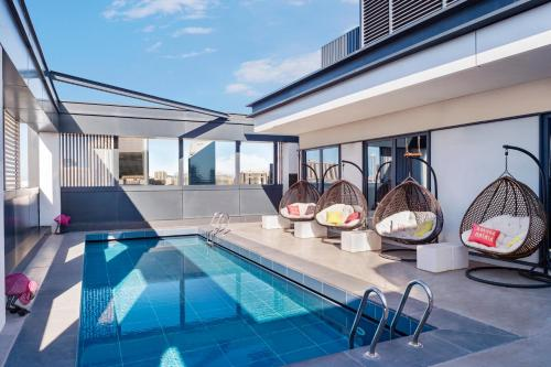 The swimming pool at or close to Hampton by Hilton Dubai Al Seef