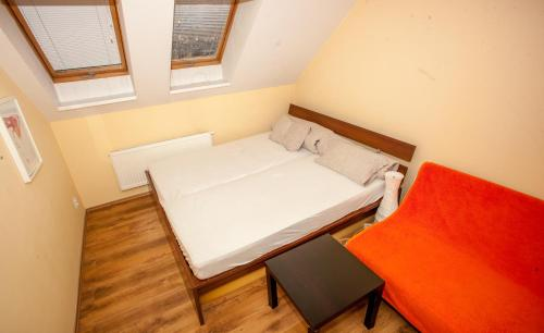 A bed or beds in a room at Prague Airport rooms