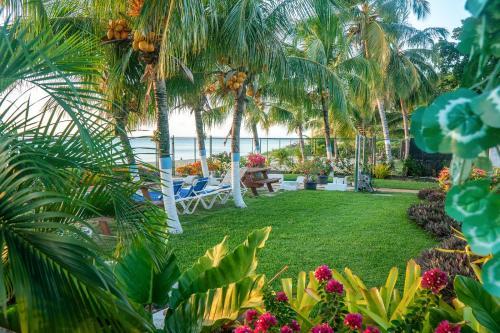 A garden outside Banyan Beach House Villa