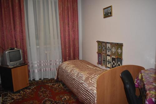 Кровать или кровати в номере Absolut Inn