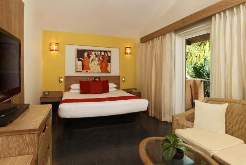 A bed or beds in a room at Lemon Tree Amarante Beach Resort, Goa