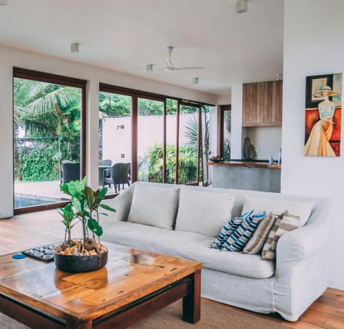 A seating area at Ubuntu Beach Villas by Reveal