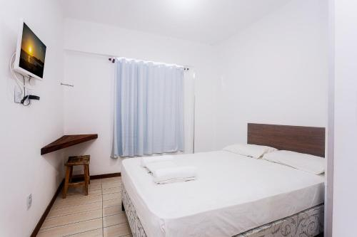 A bed or beds in a room at Economy Apart