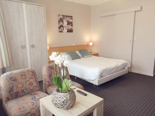 Un ou plusieurs lits dans un hébergement de l'établissement Hotel Sfinx