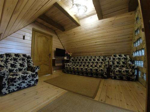 A bed or beds in a room at Agrousadba Svetlazara