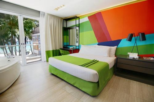 A bed or beds in a room at Boracay Uptown
