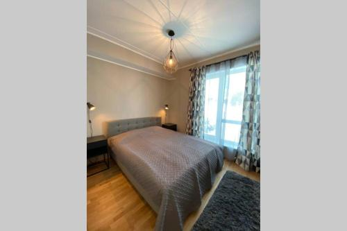 A bed or beds in a room at Overnight Tallinn