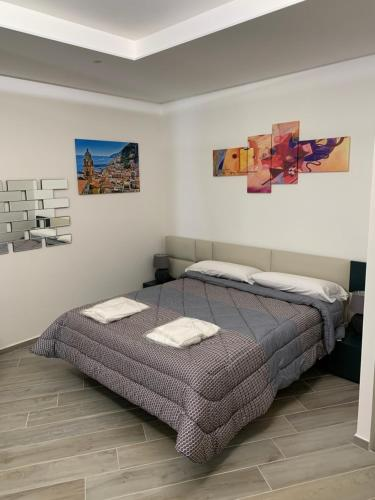 A bed or beds in a room at Home4 Apartment Salerno