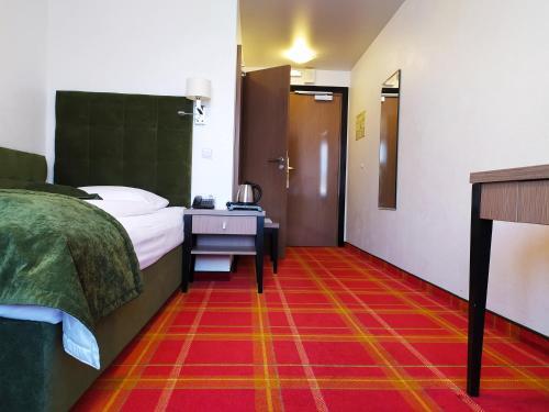 Кровать или кровати в номере Гостиница Калининград