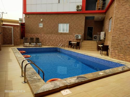 The swimming pool at or near Alim Royal Hotel and Suite
