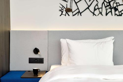 A bed or beds in a room at Radisson Blu Hotel, Bruges