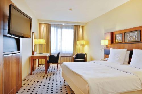 Ein Bett oder Betten in einem Zimmer der Unterkunft Radisson Blu Hotel, Hamburg Airport