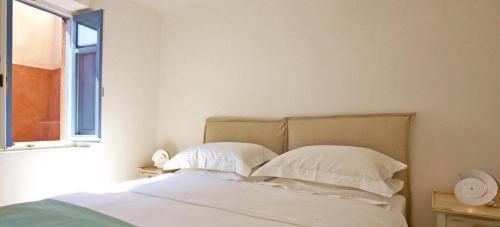 Un ou plusieurs lits dans un hébergement de l'établissement history and sophistication 5 bedrooms villa