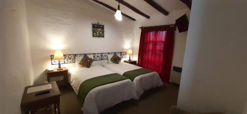 A bed or beds in a room at Hotel el Patio de Monterrey
