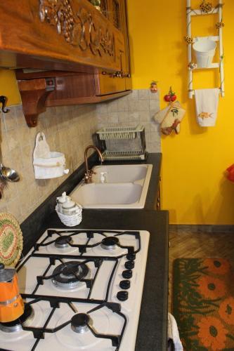 Cucina o angolo cottura di ETNA Family