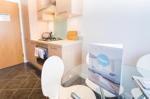 A kitchen or kitchenette at Mackie Exclusive Residence