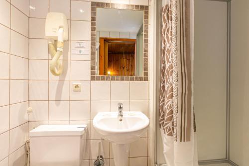 Ванная комната в Hotel Le Chamonix