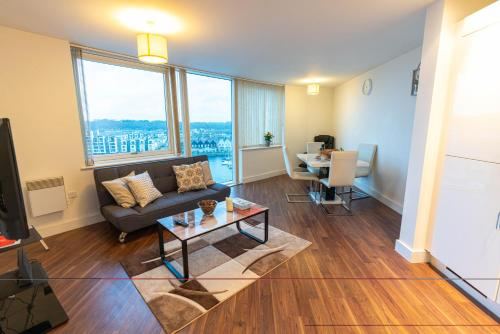 A seating area at 2 Bedroom 2 Bathroom CITY VIEW with Underground Car Park at CHATHAM MARITIME