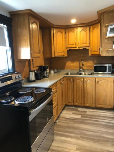 A kitchen or kitchenette at Alma's Cape Shore Cottage! Your home away from home!