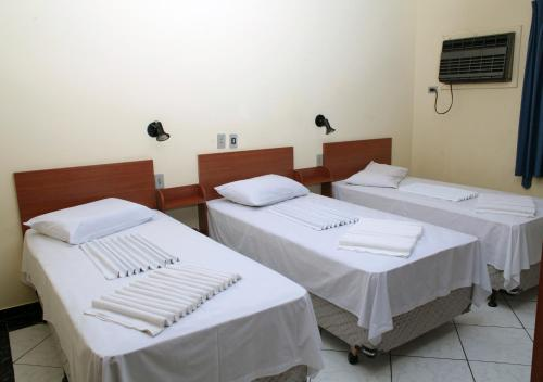 A bed or beds in a room at Hotel 15 de Julho
