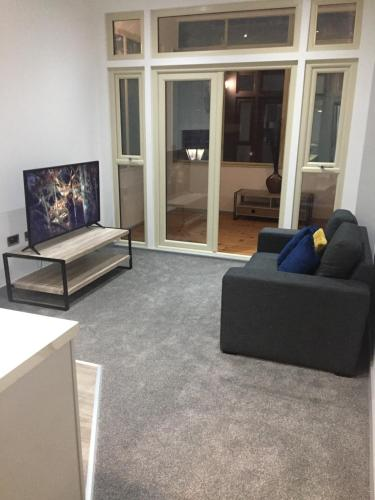 A seating area at Modern Apartment Central Doncaster