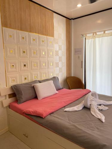 A bed or beds in a room at Monallan Boracay Hotel