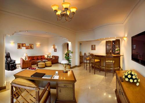 A restaurant or other place to eat at The Suryaa New Delhi
