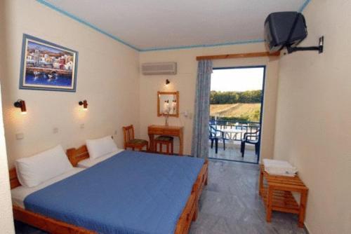 Ένα ή περισσότερα κρεβάτια σε δωμάτιο στο Ξενοδοχείο Λίντζι