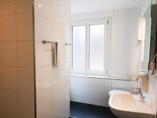 Ein Badezimmer in der Unterkunft Hotel Sonnenberg