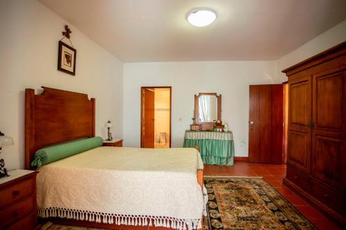 A bed or beds in a room at Casa de São Caetano de Viseu