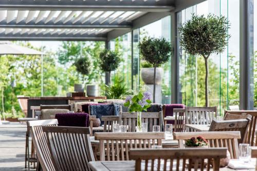En restaurang eller annat matställe på Arken Hotel & Art Garden Spa