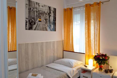 Posteľ alebo postele v izbe v ubytovaní Cracow Central Aparthotel
